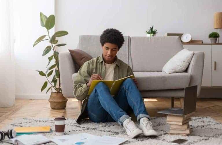 web-based-education-focused-black-teenager-writing-CTUZ5UH.jpg